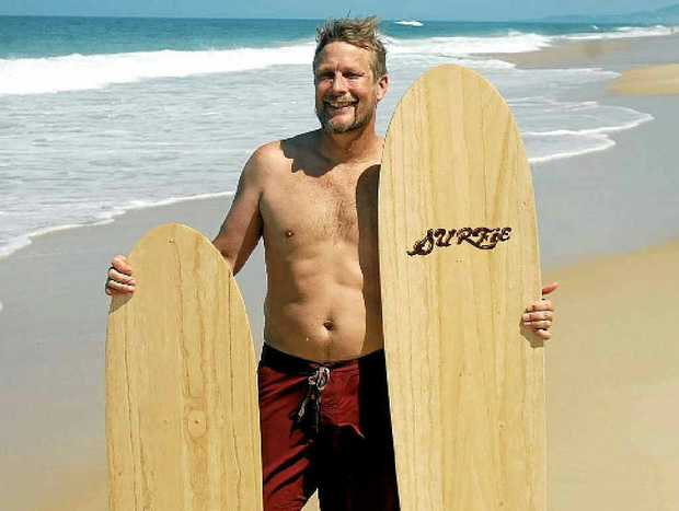 ONE SIZE FITS ALL: Surfrider Shaper Tom Wegener will bring his Surfie wooden body boards to Coolum for the Golden Days Festival next weekend for the belly boarding competition.