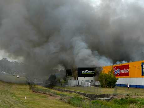 Buildings engulfed by flames at Greenfields.