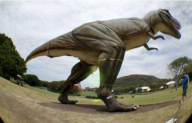 UNDER WRAPS? The T-rex replica, 'captured' in a 'secret' fish-eye lens photo, stalks the Palmer Resort fairways.
