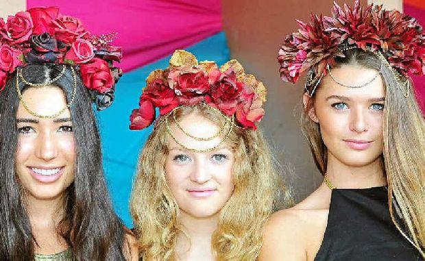 DESIGNER SHOWCASE: Elke, April and Jana model hats by Anthea Nastesar at Eumundi Markets.
