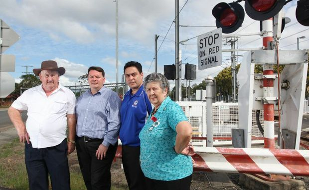 Andrew Hopkins, Luke Smith, Michael Latter and Kathy Webber are lobbying for an alternative access point to be made out of Bethania when the emergency gates are shut down at the level crossing. Photo: Inga Williams / The Reporter