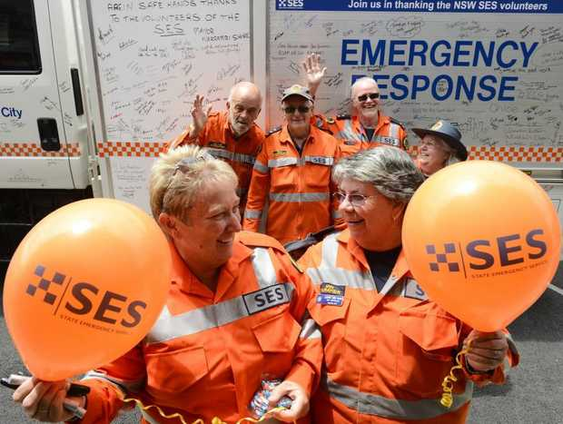 Janine Bridle of Grafton City SES and Ann Mara of Wooli Yuraygir get together with other SES members to promote SES Week in Prince St Grafton. Photo: Adam Hourigan / The Daily Examiner