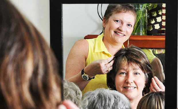 NEW LOOK: Tracy Koroleff, with ex-borrower Elizabeth Spearritt, tries out wigs at the wig library.