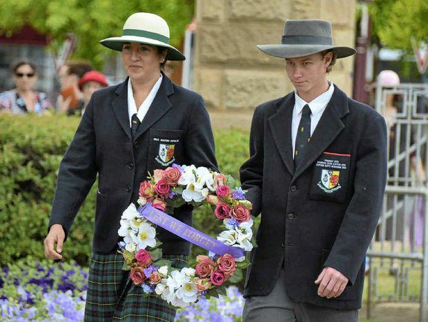 Scots PGC College girls boarding captain Shannon Kreidemann and boys boarding captain Stephen Turnbull lay a wreath at the Cenotaph yesterday.