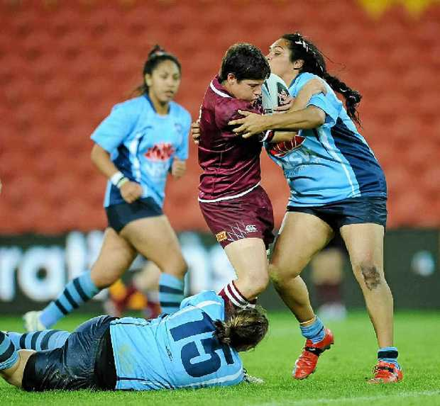 Heather Ballinger shows her style for the Maroons at Suncorp Stadium.
