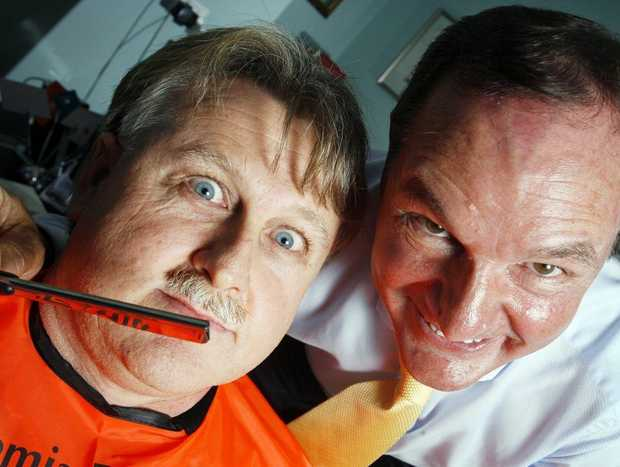 A  moustached Queensland Times Sports Editor David Lems comes in for some close attention from Ipswich Mayor Paul Pisasale.