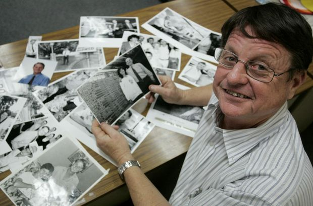 Member for Rockhampton Robert Schwarten with some photographs from early in his career, from the archives of The Morning Bulletin. Photo Sharyn O'Neill / The Morning Bulletin
