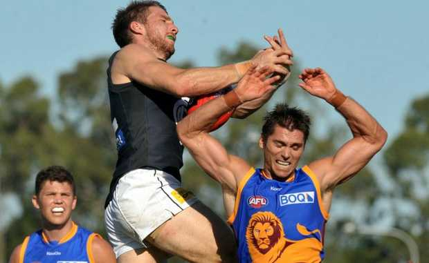 Brisbane Lions against Carlton AFL match at Maroochydore. Simon Black jumps high for the Lions. Photo:Warren Lynam / Sunshine Coast Daily