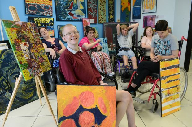 James Tisdall (front) with Stepheney Everitt, Yasmin Thompson, Mark Connelly, Jasmine Ludlow and Caroline Hudson and some of their artwork that will be on display at the Ipswich Community Gallery.