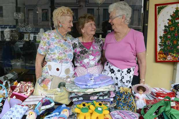 Jean Butcher, Elisie Balfour and Glenda Johnson help out at the Anglican Craft Fair street stall at Maclean. Photo Adam Hourigan / The Daily Examiner