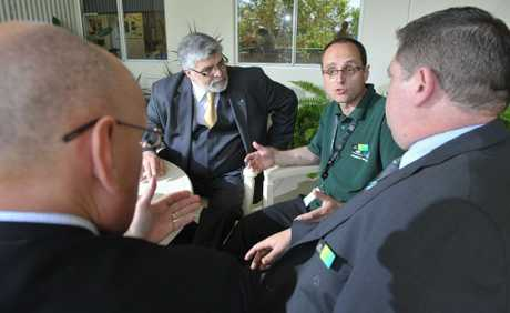 "Human Services minister Kim Carr (left) chats with Community recovery ""Green Army"" member Con Kapoulas, MP Shayne Neumann and Ipswich Centrelink manager Tony Perera at a morning tea to thank staff for their effort during the 2011 flood."