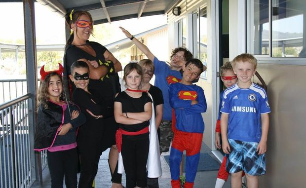 Students and teachers became super heroes at Bogangar Primary School to raise funds for The Family Centre this week. Contributed.