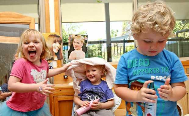 First Day on the Job! Zoe Royal, Bowie Edwards adn Judah McAndrews get stuck into some hairdressing at Kindy Photo Blainey Woodham / Daily News
