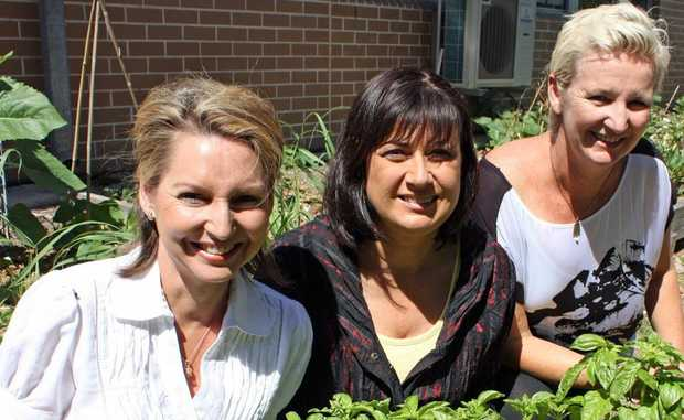Local MP Justine Elliot (centre) visited Cabarita Community Garden this week and met with organiser Karen Anderson (left) and school principal Cath Lalor (right). Photo: Contributed