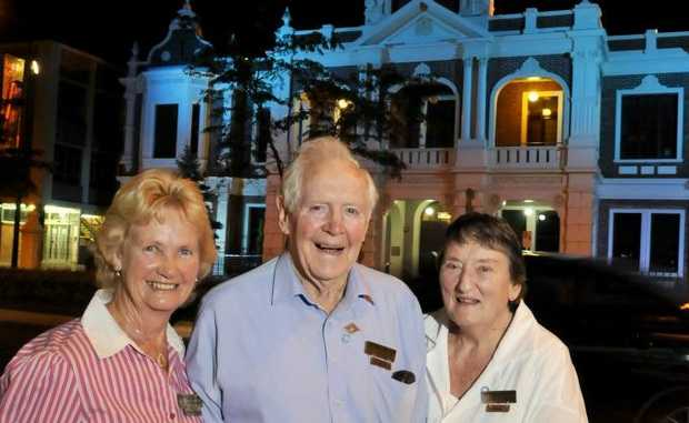 Toowoomba and Darling Downs Diabetic Support Group members (from left) Eileen Harms, Norman Devine and Sylvia Devine inspect the blue glow cast over Toowoomba Town Hall.