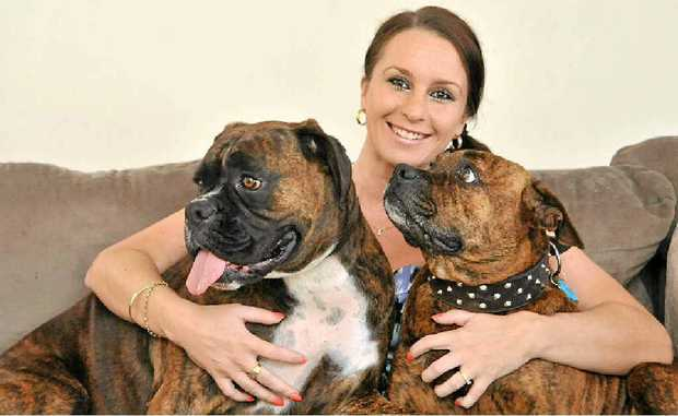 Amy Molloy with her dogs Lennox and Memphis. A new survey has found that pets are good for our wellbeing.