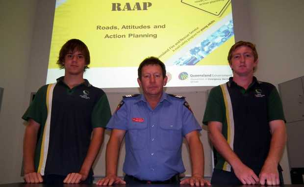 Firefighter Mark McGrath with Year 12 Xavier Catholic College students Blake Hagar and Alex Jacob.
