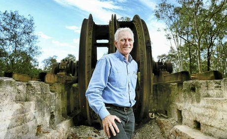 MECHANICAL MONSTER: Hugh Taylor of the Willis L Haenke Historical Foundation with the giant winder.