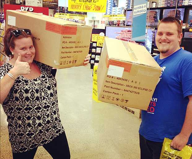 Monique Wilson and Mitchell Jenkins from tweed heads pick up their care packages for Call of Duty Photo Contributed
