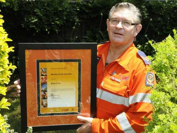 Toowoomba State Emergency Service volunteer Brian Cook celebrates winning the regional member of the year award.