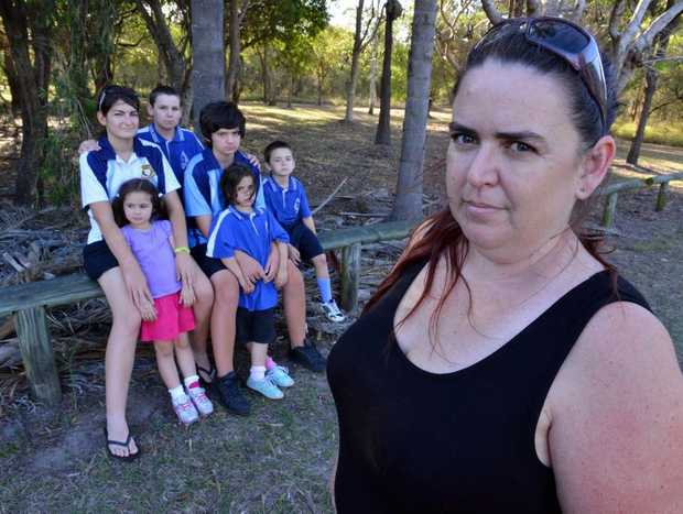 HOME WANTED: Amanda Davis and her children Carmel and Ron Johnston, Alexander Knight, Jarred, Jessika and Jacklyn Cuccuru are desperately in need of a home. Photo: Scottie Simmonds / NewsMail