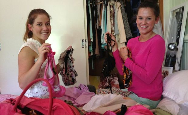 Phoebe Cottle (left) and Imogen Hoffenberg pack for schoolies week 2012.