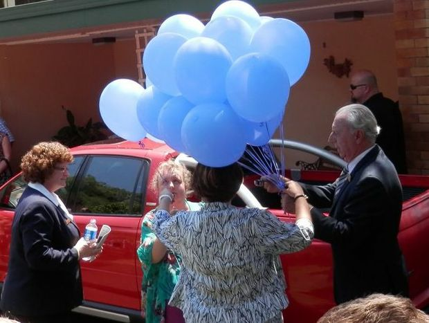 Joanne Lasker receives a balloon symbolising a year of her son's short life at yesterday's funeral at the Garden of Remembrance.