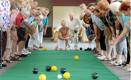 HAPPY DAYS: Residents watch Margaret Lohman and Jim Bolger play indoor bowls on the new mats donated to Bremer Waters.
