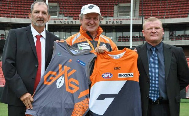 GOOD MOVE: AFL coach Kevin Sheedy (centre) has pledged to support the new Greater Western Suburbs under-18 team in Ipswich. Sharing Sheedy's enthusiasm are GWS assistant coach Fred Meddings (left) and Collingwood Park Magpies vice-president Dean Hooley.