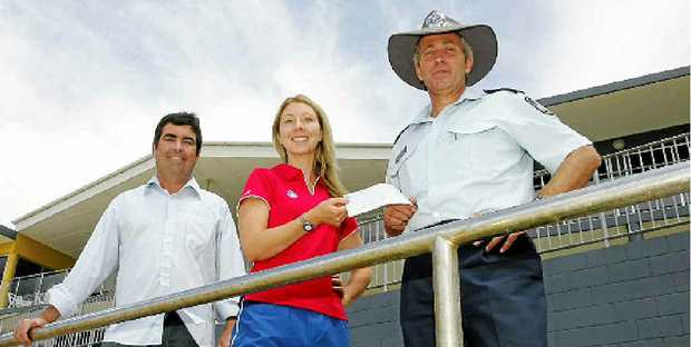 CHARITY DAY: Coolum Surf Club secretary Paul Hammond, Summer Surf Girl entrant Kate Norman and Senior Sergeant Hardy Wirth.