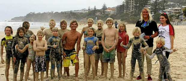 "SUPER GROMS: Coolum pro junior surfer Kelly Norris and the ""crumbed sausages"" ."