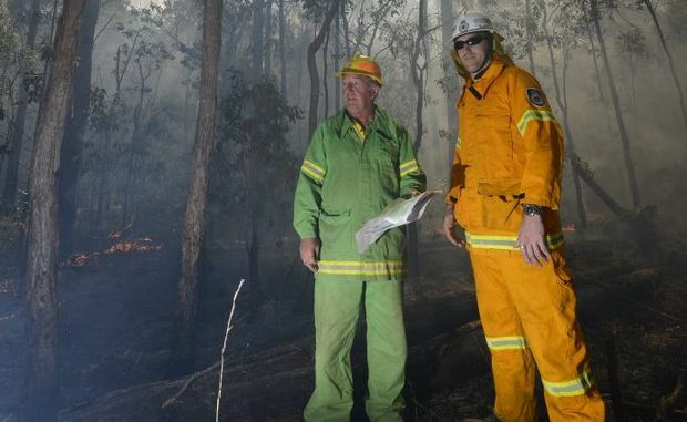 Division Commander Forests NSW David Blair and Rural Fire Service Matt Inwood look over the situation in the Candole State Forest Photo Adam Hourigan / The Daily Examiner