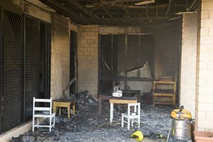 The charred interior of the Currawong St home.