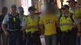 Police arrest a man in Surfers Paradise on the eve of Schoolies 2012.