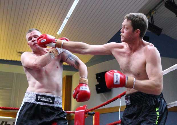WHACK! Brett Peters throws a punch at Michael O'Donnell at Oakey on Saturday. Picture: Darren Burns