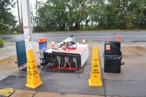 A bowser at Woodburn's Caltex service station, which was knocked over during the storm.