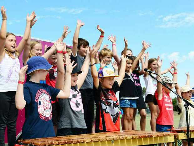 HANDS UP: Amberley District State School year 3 class performs for the crowd at the 150th anniversary fete.