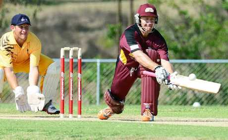 Andy Bichel plays a reverse sweep shot for the Bulls Masters yesterday against the Ipswich Invitational side.