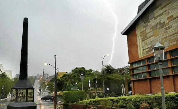 HERE IT COMES: Lightning and heavy rains hit the Ipswich region as predicted, but not as heavily as first thought.