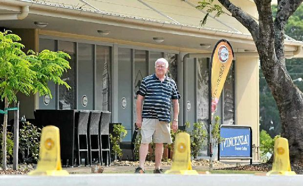 BLOCKAGE: Tony Cross is angry that bollards have been placed on the double white lines outside Cimani Fine Foods in King St, Buderim.