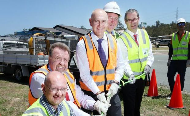Shayne Neumann, Paul Tully, Bernie Ripoll, Paul Rees and Stephen Conroy laying the first cable of the national broadband neetwork in Goodna. yesterdayPhoto: Inga Williams / The Satellite