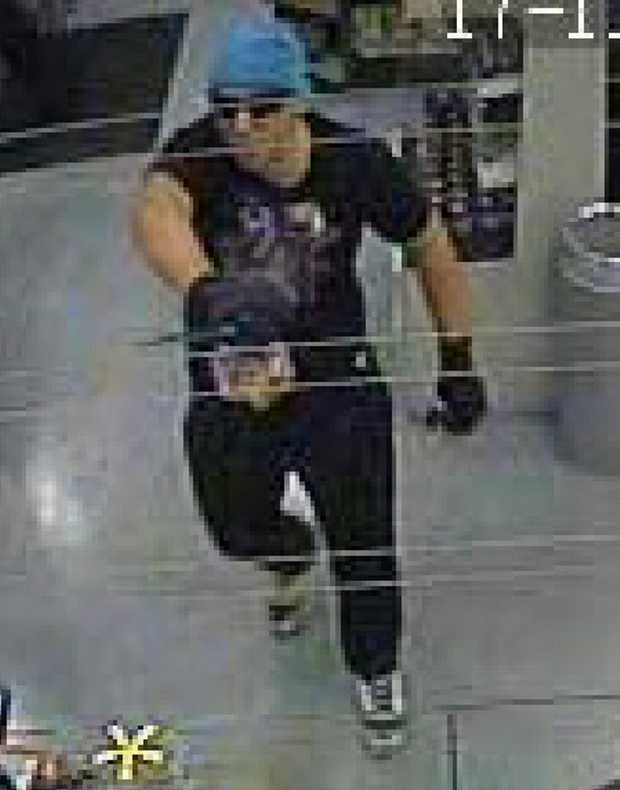 CCTV footage of a man involved in an armed robbery in Toowoomba on Saturday night.