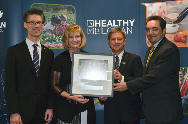 WELL DONE: Heart Foundation CEO Cameron Prout presents the award to Logan Mayor Pam Parker, Logan City Council CEO Chris Rose and Councillor Phil Pidgeon. Photo: Supplied