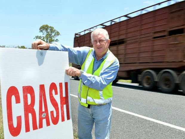 Mackay Road Accident Action Group's Graeme Ransley has put up about 80 signs along the Bruce Hwy urging safe driving over the Christmas break.