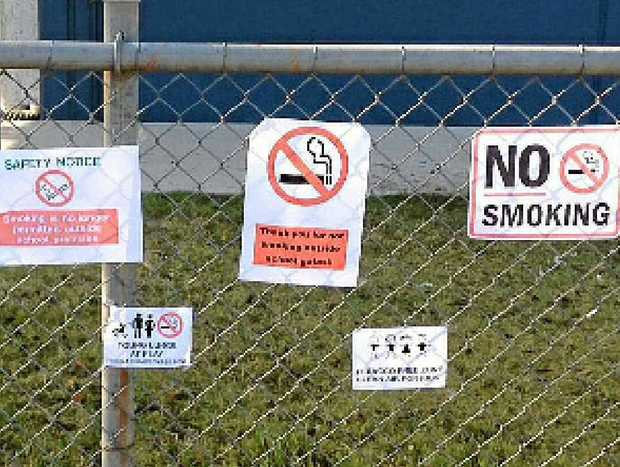 The anti-smoking signs erected on the fence of a school by angry parents.