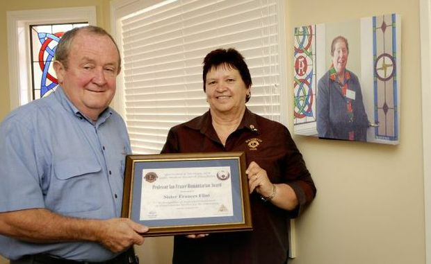Toowoomba Hospice chairman Graham Barron and Wilsonton Lions Club immediate past president Carmel Goldsworthy with the humanitarian award given to the late Sister Frances Flint.