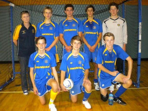 WINNERS: The Toowoomba Grammar School under 16 futsal team of Jack Waters (back left), Connor Simon, Riley Cooper, Janelle Cooper (coach), Michael van Gend, Coen Oates, Mitchell Hunter and Matthew Crowe.
