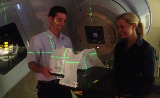 Radiation therapists Peter Neville and Emma Knakes with the new IMRT machine Photo Albert Elzinga / Daily News