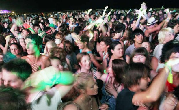 Thousands of young people party hard at one of the organised events at Schoolies on the Gold Coast.
