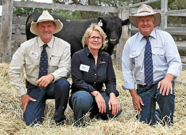 LEFT, FIRST TIME SUCCESS: Jim Wedge and Jackie Chard with auctioneer Craig Thomas from Colin Say and Co, Glen Innes, with the top priced Angus bull after their first on-property Ascot bull sale.